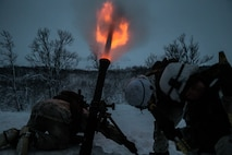 U.S. Marines with Marine Rotational Force-Europe (MRF-E) 19.1 fire a M252 81 mm mortar system in Setermoen, Norway, Nov 27, 2018.