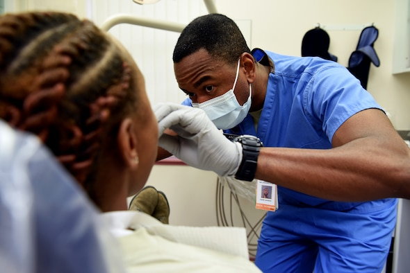 U.S. Air Force Tech. Sgt. Andre Andrews, 48th Dental Squadron dental technician, creates dental impressions for a Team Mildenhall Airman at the RAF Mildenhall Dental Clinic, RAF Mildenhall, England, Dec. 3, 2018. The 48th DS consists of four flights – the dental clinic, dental support and dental laboratory on RAF Lakenheath and the dental clinic on RAF Mildenhall. (U.S. Air Force photo by Airman 1st Class Brandon Esau)