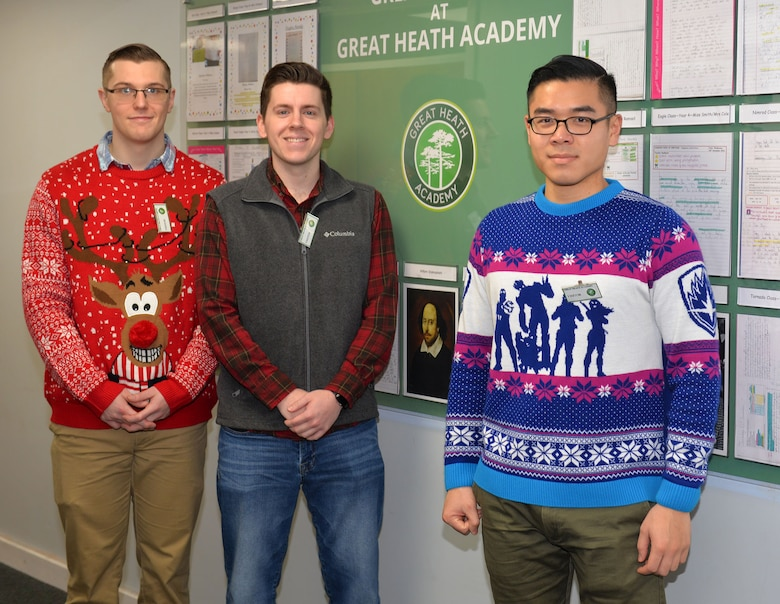 "U.S. Air Force Roy Smith, Airman 1st Class Logan Westbrooks and Senior Airman Alan Deng all 100th Communications Squadron members, pose for a photo at Great Heath Academy, Mildenhall, Suffolk, before ""Radio Santa"" Dec. 18, 2018. Radio Santa is a program run by 100th CS Airmen from RAF Mildenhall, which provides young local school children the opportunity to talk to Santa Claus. The Airmen also visited children at Beck Row Primary Academy. (U.S. Air Force photo by Karen Abeyasekere)"