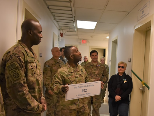 Distinguished Visitors will now be able to spend their time at the Afghanistan District in the Bonnie Corbin Suite, Room 212 as the command and staff dedicated it in Corbin's name prior to her departure