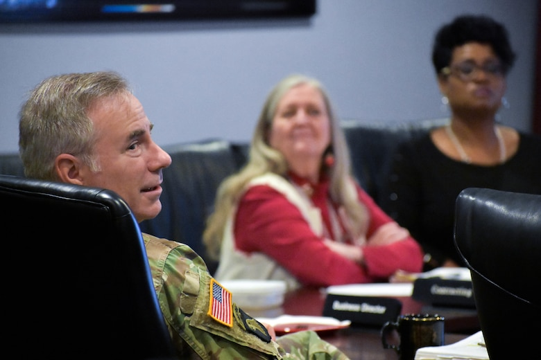 U.S. Army Colonel John Hurley, commander of the U.S. Army Engineering and Support Center, Huntsville, listens to project updates during a monthly Project Review Board at the Center in Huntsville, Alabama, Dec. 12, 2018.