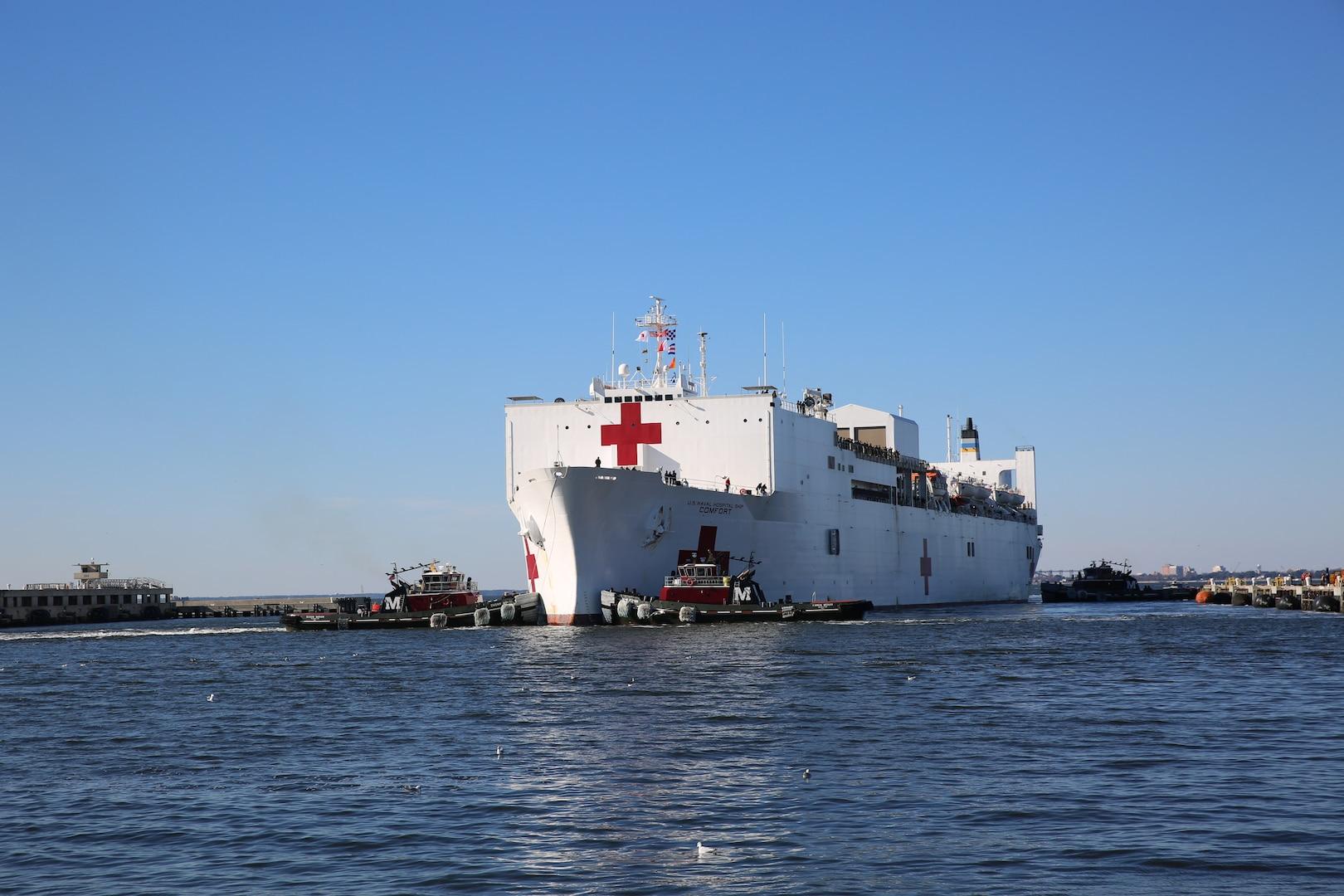 Military Sealift Command's hospital ship USNS Comfort (T-AH 20) pulls into Naval Station Norfolk, Dec. 18.