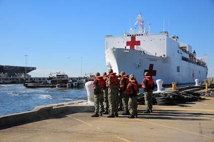 Military Sealift Command's hospital ship USNS Comfort (T-AH 20) pulls into Naval Station Norfolk, Dec. 18.