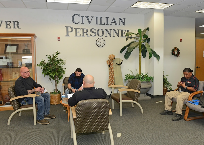 Maintenance job candidates sit in the waiting area on the second floor of Bldg. 3000 Dec. 13. The 412th Test Wing held a one-day direct hiring event where suitable job candidates were invited to Edwards to interview and conduct pre-employment requirements all in one day. (U.S. Air Force photo by Kenji Thuloweit)