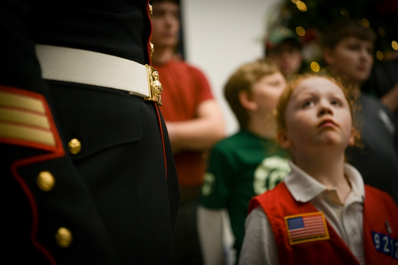 Staff Sgt. Terry Allen Davis Jr., left, 451st Combat Logistics Battalion training chief, looks on as a local business unveils the number of gifts they donated Dec. 14, 2018, on Johns Island, S.C. All of the toys were donated by individuals and businesses within the Lowcountry and given to those in the community who may have for one reason or another fallen on hard times during the holiday season. The goal of the program is to, help bring the joy of Christmas and send a message of hope to America's less fortunate children through the gift of a new toy.