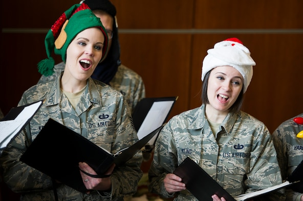 U.S. Air Force Band Singing Sergeants Tech Sgts. Ashley Keeks, left, and Adrienne Kling sing Christmas Carols at Joint Base Andrews, Md., Dec. 19, 2018. (U.S. Air Force photo by Master Sgt. Michael B. Keller)