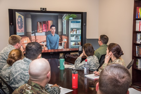 In one of the capstone events for the Leader Development Course for Squadron Command students are placed into a 'virtual' scenario-based, experiential exercise. Students use the knowledge gained during the eight-day course to effectively communicate with different personality types in real-world derived situations. The capstone event depicted in the image was held Nov. 8, 2018, at Air University, Maxwell Air Force Base, Alabama. (U.S. Air Force photo by William Birchfield)