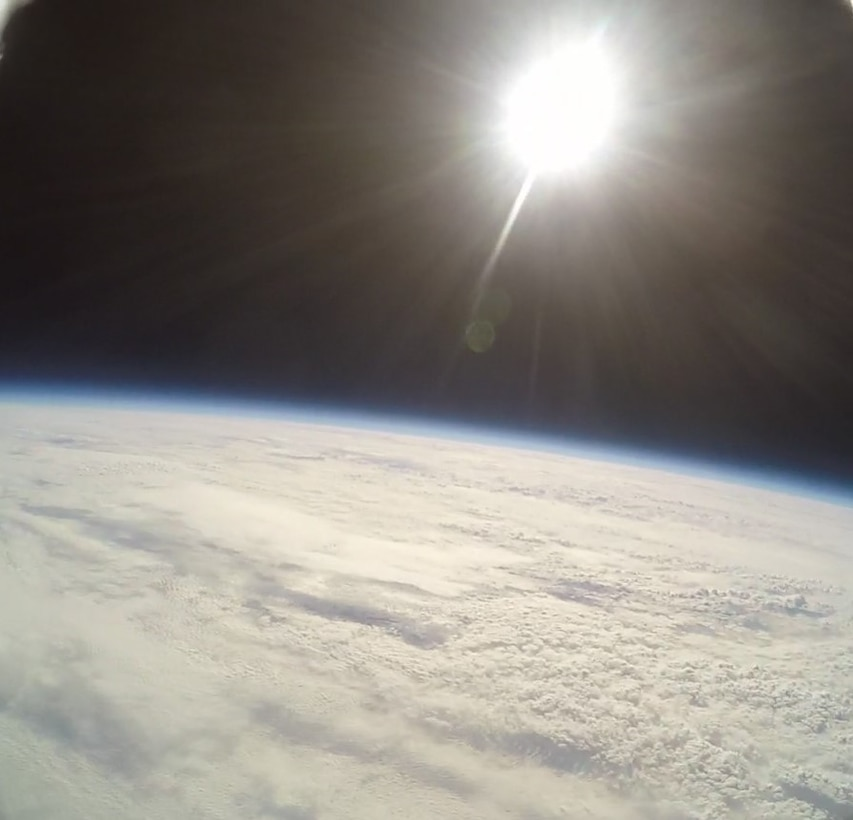 A GoPro attached to a high-altitude computer and floating over Illinois records the sun and horizon over earth, which was done as part of a final project for a group of eighth grade students from three schools, Nov. 30, 2018. The balloon reached a maximum altitude of 22.5 miles and recorded a temperature low of 67 degrees Fahrenheit. The balloon launch was made possible through an Air Force science, technology, engineering, and mathematics grant.