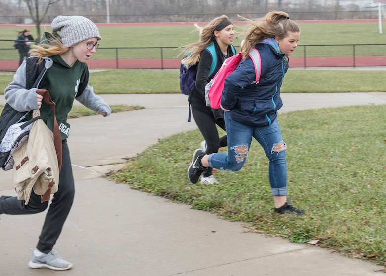 Abby Carlton, Savannah Hoffman, and Allyssa Owen, Smithton Middle School eighth graders, rush to the school bus to retrieve the recently launched high-altitude computer after their year-long science, technology, engineering, and mathematics project made possible through an Air Force STEM grant, Nov. 30, 2018, Belleville, Illinois. Three schools, Emge Junior High School, Smithton Middle School and Belle Valley School, worked together to launch a balloon that carried a high-altitude computer, which analyzed data ranging from altitude and coordinates traveled to temperature and pressure. The students found the popped balloon 140 miles away in Mount Carmel, Illinois.