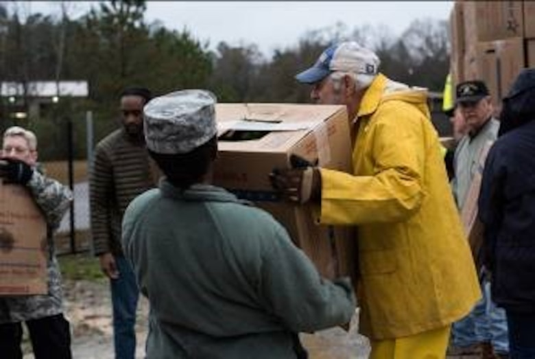 A Maxwell Airmen assists local community members in the unloading and sorting of 6,000 wreates for the Wreathes Across America ceremony Dec. 14, 2018, at the Alabama National Cemetery, in Montevallo, Alabama. The mission of Wreaths Across America is to honor our country's fallen veterans during the holidays, when their families are missing them most. (U.S. Air Force photo by Senior Airman Alexa Culbert)
