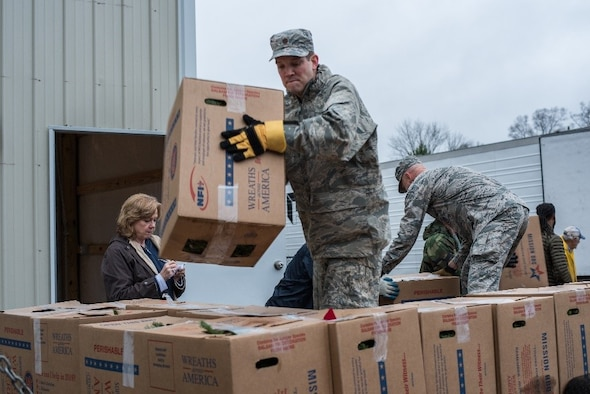 A Maxwell Airmen sorts boxes of wreaths for the Wreaths Across America ceremony Dec. 14, 2018, at the Alabama National Cemetery, in Montevallo, Alabama. Wreaths Across America is an organization that honors our country's veterans by coordinating wreath laying ceremonies every December. (U.S. Air Force photo by Senior Airman Alexa Culbert)