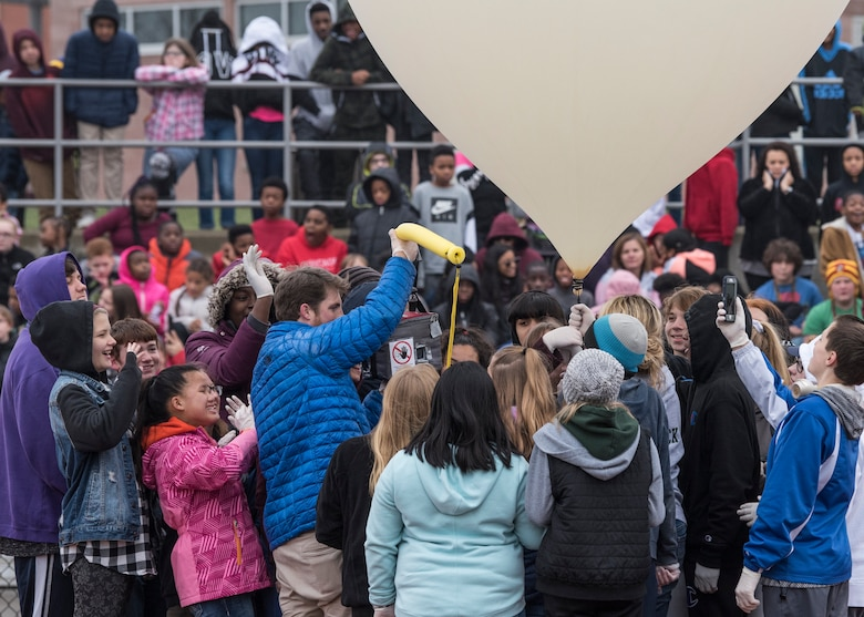 Approximately 650 students watch as eighth graders execute their year-long science, technology, engineering, and mathematics project made possible through an Air Force STEM grant, Nov. 30, 2018, Belleville, Illinois. Three schools, Emge Junior High School, Smithton Middle School and Belle Valley School, worked together to launch a balloon that carried a high-altitude computer, which analyzed data ranging from altitude and coordinates traveled to temperature and pressure. The students found the popped balloon 140 miles away in Mount Carmel, Illinois.