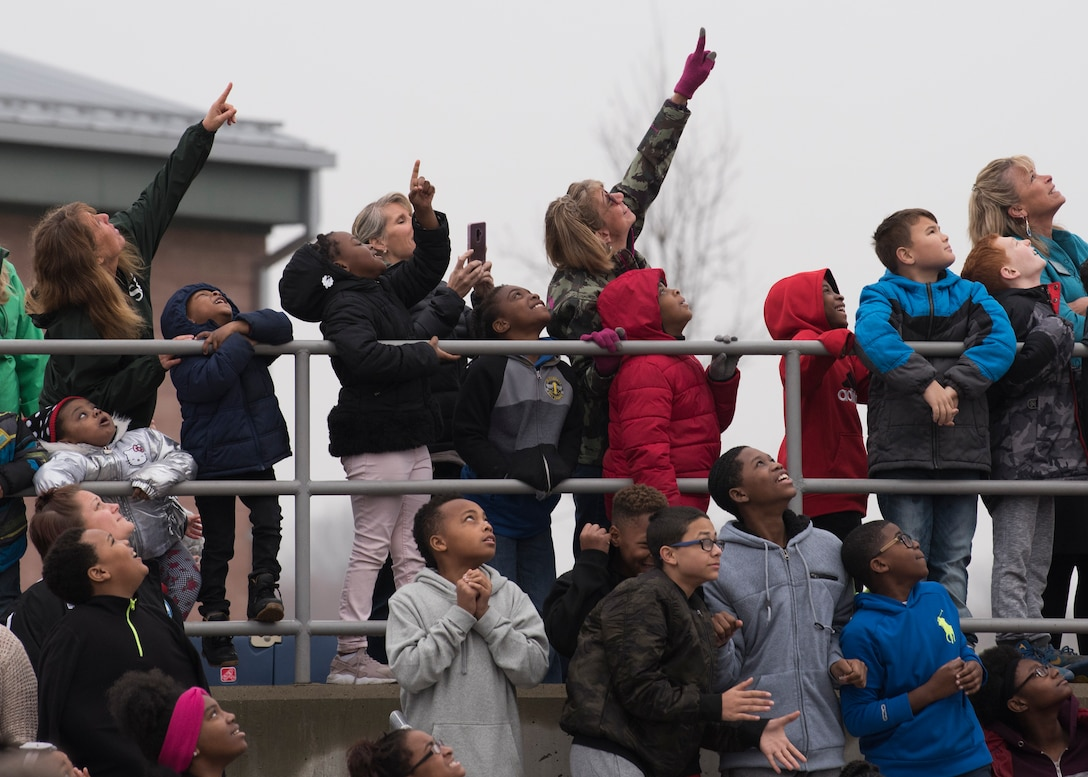 Belle Valley School students watch as a high-altitude computer floats into the sky, Nov. 30, 2018, Belleville, Illinois. Three schools, Emge Junior High School, Smithton Middle School and Belle Valley School, worked together to launch a balloon that carried a high-altitude computer, which analyzed data ranging from altitude and coordinates traveled to temperature and pressure. The students found the popped balloon 140 miles away in Mount Carmel, Illinois. The project made possible through an Air Force science, technology, engineering, and mathematics grant.