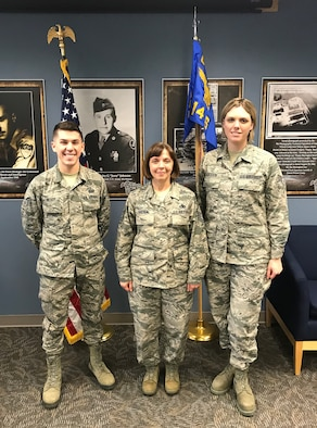 (left) Senior Airman Alexander Neery, 14 Intelligence Squadron intelligence analyst, and (right) Senior Airman Amanda Logsdon, 14 IS intelligence analyst, were presented the Diamond Sharp Award by (middle) Master Sgt. Angela Hayden, 14 IS first sergeant, during the December 16, 2018 unit training assembly.