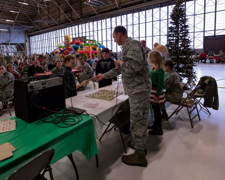 Col. Johan Deutscher, commander of the 141st Air Refueling Wing, checks bingo cards during the wing's annual Winter Fest Dec. 1, 2018 at Fairchild Air Force Base, Wash. More than 900 Airmen assigned to the 141st are welcome to take part in the festivities along with their families to celebrate the holiday season. (U.S. Air National Guard photo by Staff Sgt. Rose M. Lust/Released)