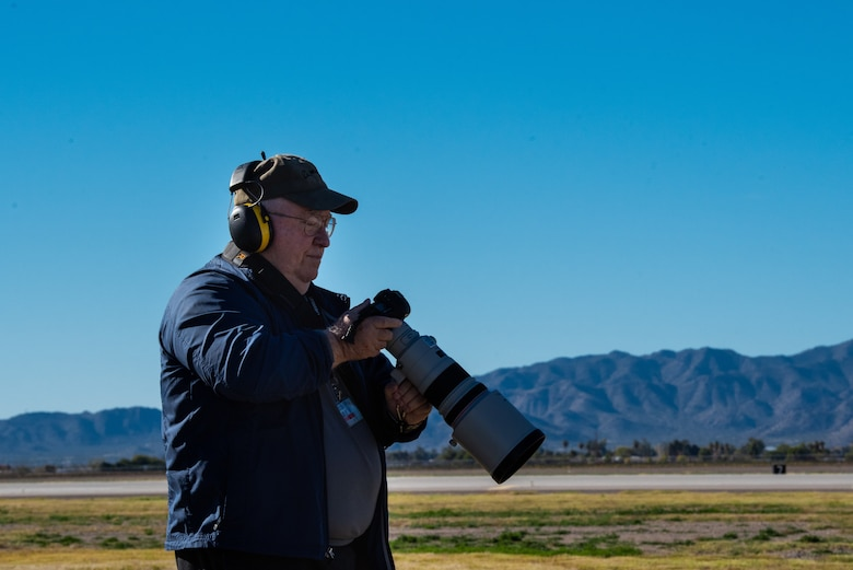 Harvey Brugger, 56th Operations Support Squadron air traffic controller, looks over his flight line imagery, Dec. 13, 2018, at Luke Air Force Base, Ariz.