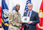 "Defense Logistics Agency Director Army Lt. Gen. Darrell Williams presents a ""Ya Done Good"" award to Maritime Supplier Operations Deputy Director Ben Roberts. DLA Land Aberdeen Director Doug Nevins and Supervisory Contract Specialist Bill Winegarner also received ""Ya Done Good"" awards."