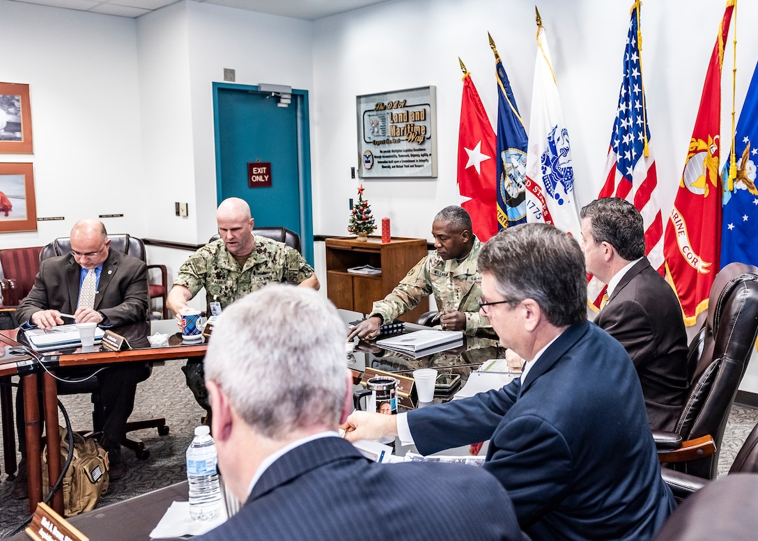 DLA and Land and Maritime leadership sit at u-shaped table for annual meeting