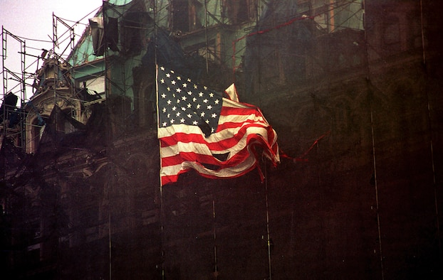 An American flag waves at Ground Zero, formerly the World Trade Center, New York City, N.Y., Sept. 14, 2001.