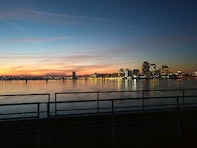 McAlpine Locks and Dam maintenance mechanic captures the morning sun over the city of Louisville. (USACE photo by CJ Bostock)