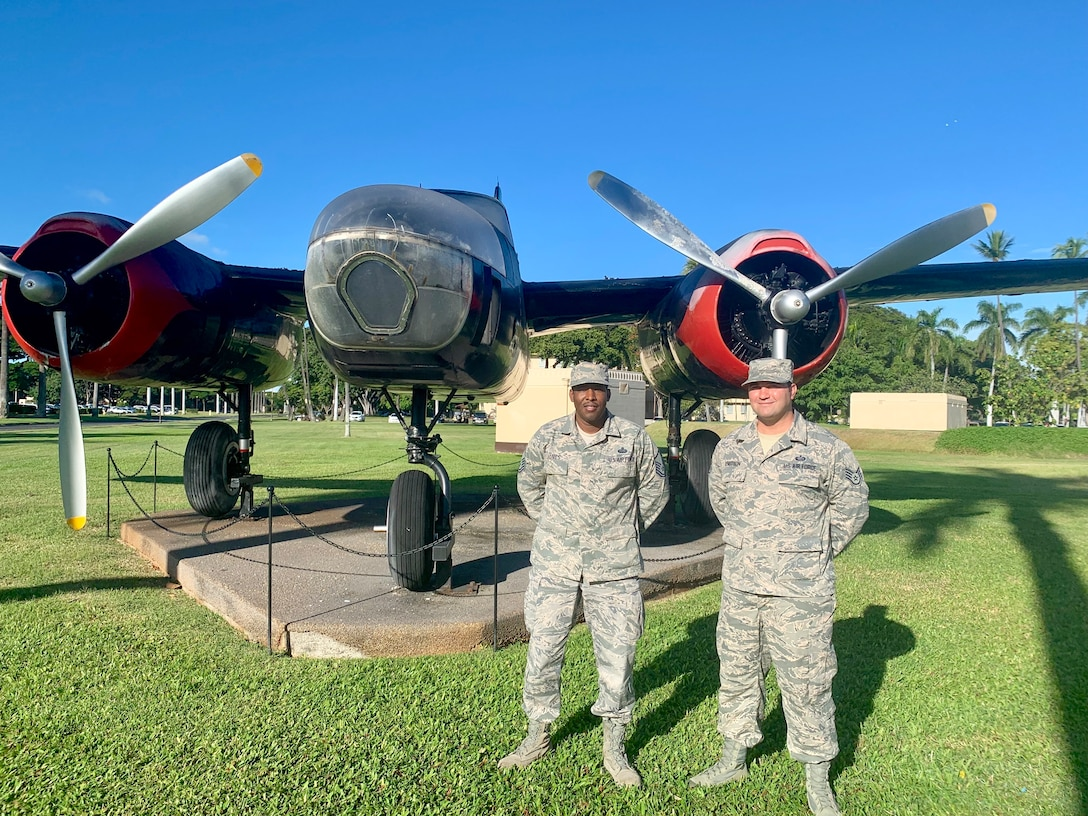 """Master Sgt. Shamar Jones, 690th Cyber Operations Squadron, and Staff Sgt. David Knutson, 647th Force Support Squadron, along with Capt. Tiffany Harwood, 15th Medical Operations Squadron, who was unavailable for a photo, won first place in the first-ever Aloha Spark competition. Their idea to implement signs alerting drivers to turn around prior to reaching the base garnered 131 """"likes"""" on the 15th Wing Facebook page. Col. Halsey Burks, 15th Wing commander, announced the Joint Base Pearl Harbor-Hickam leadership is currently working with the State of Hawaii on this issue. (U.S. Air Force photo by 2nd Lt. Amber R. Kelly-Herard)"""
