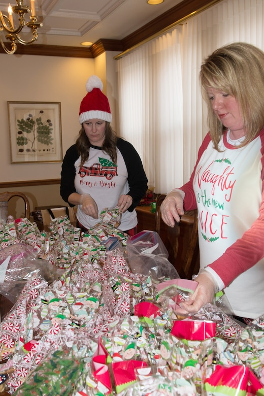 Angela Durham, wife of army Lt. Col. Christian Durham, U. S. Strategic Command, and Jennifer Rachel, wife of Lt. Col. Derek Rachel, 338th Combat Training Squadron commander, bags homemade cookies Dec. 18, 2018, at Quarters 13, Offutt Air Force Base, Nebraska. Military spouses baked four dozen cookies each for the dormitory residents. (U.S. Air Force photo by L. Cunningham)
