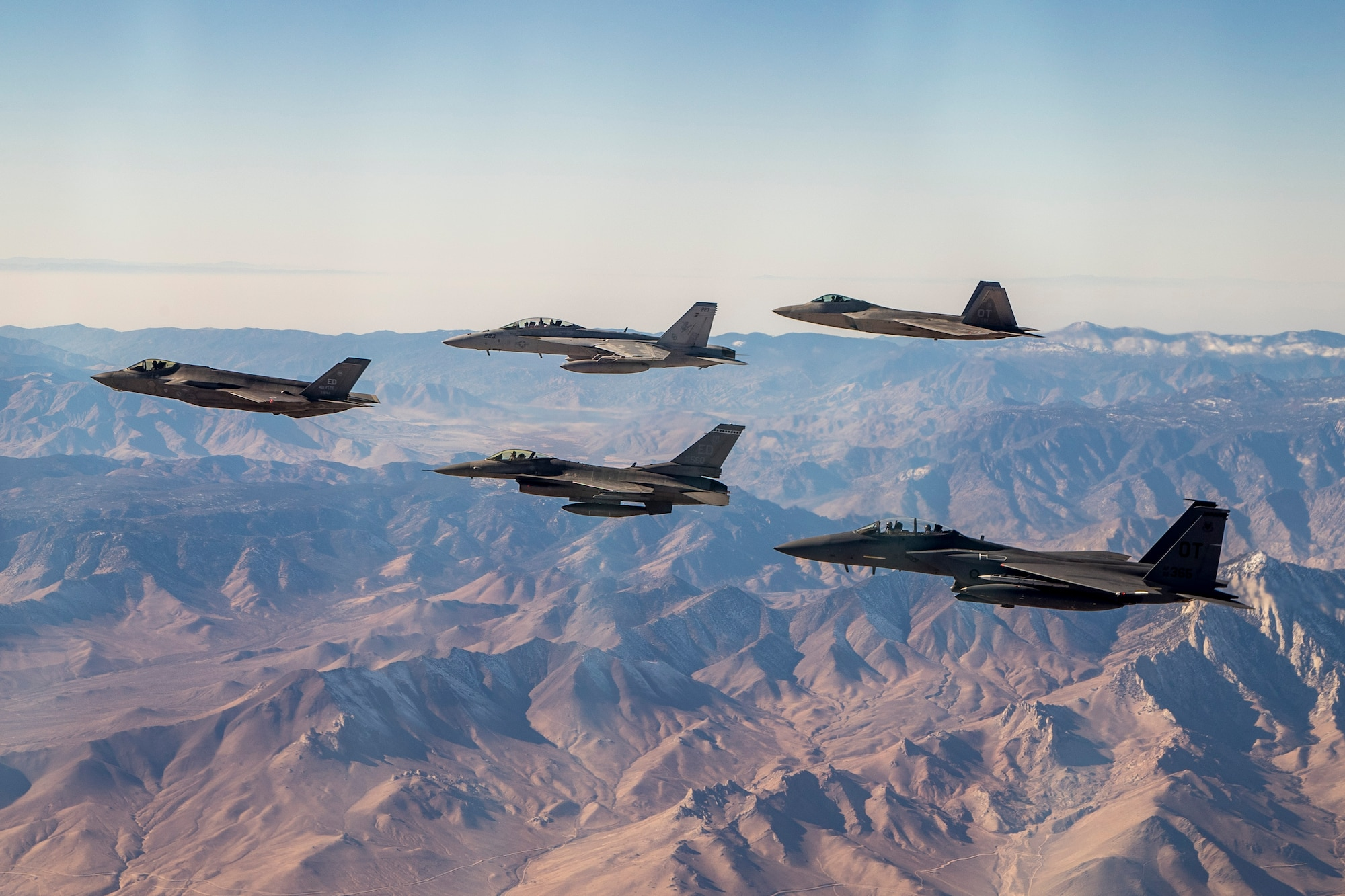 An F-35 and F-16 from Edwards Air Force Base are joined by an F-15E and F-22 from the 422nd Test and Evaluation Squadron out of Nellis Air Force Base, Nevada, along with a Navy F-18 from Air Test and Evaluation Squadron 31 out of Naval Air Weapons Station China Lake, California, Dec. 31. (U.S. Air Force photo by Ethan Wagner)