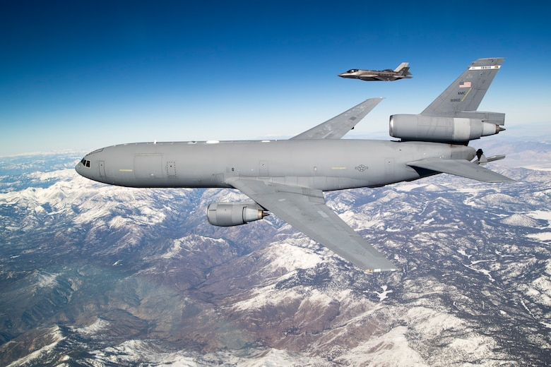 A KC-10 Extender aerial refueling tanker from Travis Air Force Base, California, flies alongside an F-35 Lightning II from the 461st Flight Test Squadron as part of the fourth Orange Flag test event this year, Dec. 13. (U.S. Air Force photo by Ethan Wagner)