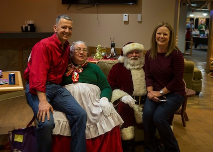 U.S. Marine Corps Col. William C. Gray, commanding officer of 6th Marine Corps District, far left, and his wife Debbie Gray, far right, pose for a photo with Mr. and Mrs. Clause, during the 6th MCD Holiday Dinner at Afterburners aboard Marine Corps Air Station Beaufort, South Carolina, Dec. 14, 2018. Vivian and Ray Otto are both natives of Mechanicsville, Virginia. (U.S. Marine Corps photo by Lance Cpl. Jack A. E. Rigsby)