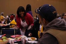 Judge Tamia Gordon, a former U.S. Marine Corps major, serves a Thanksgiving meal at the New Orleans Convention Center, Nov. 22, 2018. 