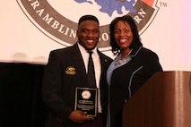 Judge Tamia Gordon, a former U.S. Marine, presents a United States Marine Corps Excellence in Leadership award to De'Arius Christmas, a Grambling State University linebacker, at the Leadership Awards Coaches Luncheon in New Orleans, Nov 23, 2018. 