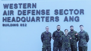 The Western Air Defense Sector hosted air battle managers of the Royal Canadian Air Force for a five week period this fall in order to complete their qualification training.  Members of 12 Radar Squadron, 3 Wing, pose in front of the Western Air Defense Sector Nov. 15, 2018 on Joint Base Lewis-McChord, Washington.  From left to right, Lt. James McGuigan, Capt. Matt Smith, 2nd Lt. Sophie Guerin, Capt. Kevin Vincent and Lt. Anthony Dufour. (Courtesy photo)