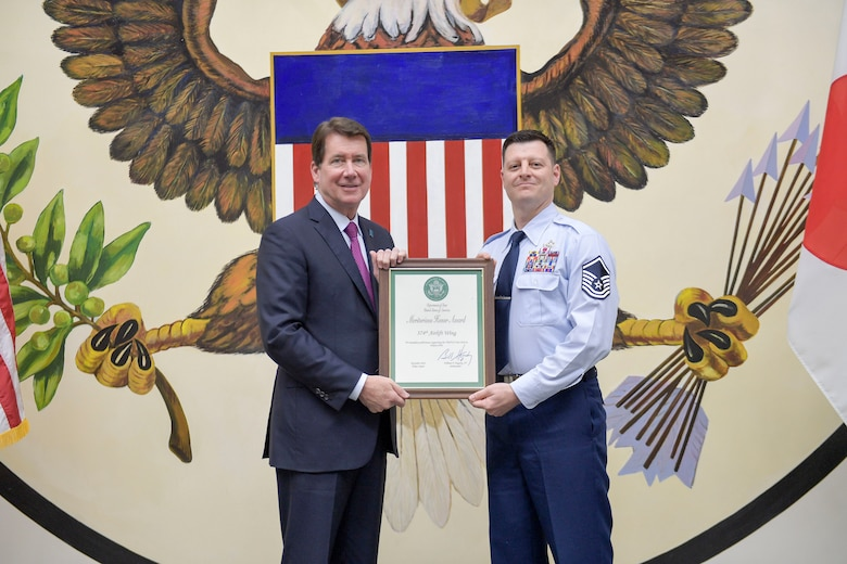 "U.S. Ambassador to Japan William F. ""Bill"" Hagerty IV, and U.S. Air Force Master Sgt. Johnathan Marker, 374th Logistics Readiness Squadron fuels operation section chief, pose for a photo"
