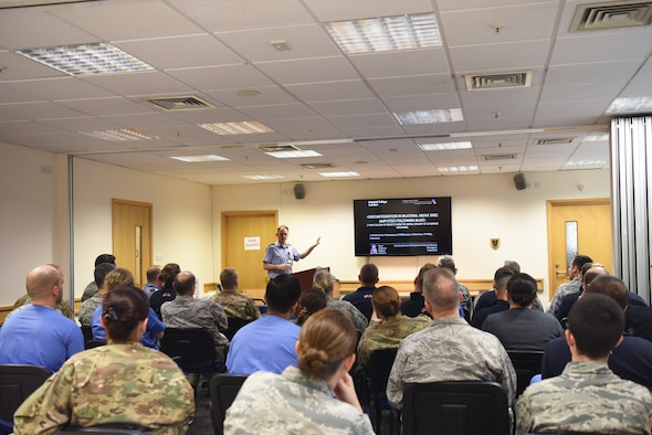 Royal Air Force Gp. Capt. Jon Kendrew briefs 48th Medical Group personnel at RAF Lakenheath, England, Dec. 19, 2018. Kendrew is an orthopedic consultant in the RAF who has majored in intraosseous integration of prosthetics for amputee service members. (U.S. Air Force photo by Airman 1st Class Shanice Williams-Jones)