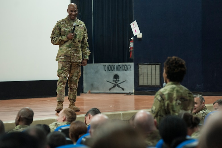 "Chief Master Sgt. of the Air Force Kaleth O. Wright answers an Airman's question during a base-wide ""all call"" at Al Udeid Air Base, Qatar, Dec. 19, 2018. Along with offering a ""heartfelt thank you,"" Wright discussed recent changes to the enlisted assignments system, notably base-of-preference options for Airmen as well as the advertisement of Continental United States assignments for Airmen who have 48-months of time-on-station service time. (U.S. Air Force photo by Tech. Sgt. Christopher Hubenthal)"