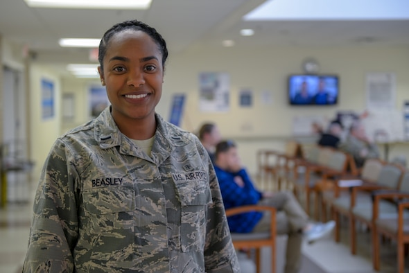U.S. Air Force 1st Lt. Valyn Beasley, 55th Medical Group practice manager healthcare administer, poses for a photo Dec. 19, 2018, at the Ehrling Bergquist Clinic, Bellevue, Nebraska. Beasley was recently admitted into the National Coalition of 100 Black Women of Omaha, a non-profit advocacy organization designed to increase the economic growth, health & wellness, educational, political and social gains for women of color, in recognition for her community service. (U.S. Air Force photo by Tech. Sgt. Rachelle Blake)