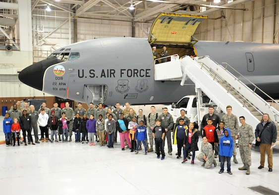 Airmen pose for a photo with children from Big Brothers Big Sisters Dec. 19, 2018, at McConnell Air Force Base, Kansas. Operation Santa brought children and Airmen together, where they toured static displays, build gingerbread houses and received little gifts. (U.S. Air Force photo by Staff Sgt. David Bernal Del Agua)