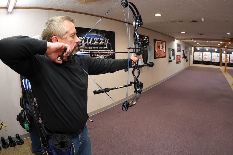 Brian Wade aims his compound bow at a three-spot target during a Hill Archery Club league night Dec. 13, 2018, at Hill Air Force Base, Utah. Besides access to the clubhouse and ranges 24/7, Hill club members are also invited to participate in several archery events throughout the year.  (U.S. Air Force photo by Cynthia Griggs)