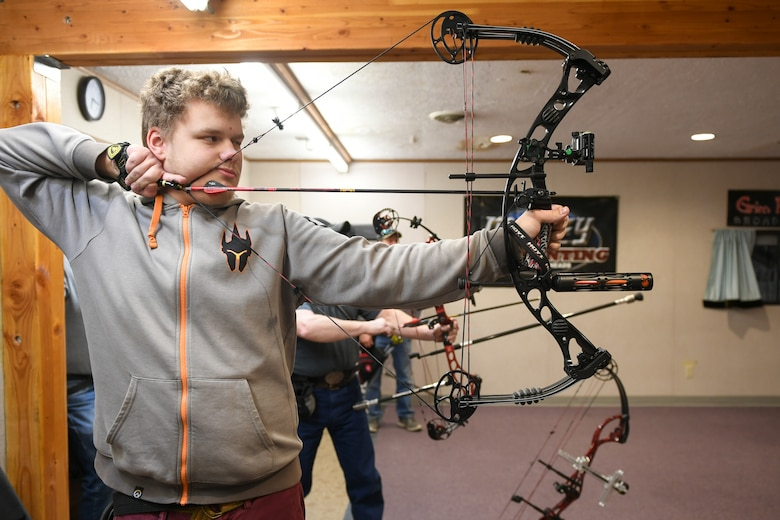 Kevin Tracy aims his compound bow at a three-spot target during a Hill Archery Club league night Dec. 13, 2018, at Hill Air Force Base, Utah. Besides access to the clubhouse and ranges 24/7, Hill club members are also invited to participate in several archery events throughout the year. (U.S. Air Force photo by Cynthia Griggs)