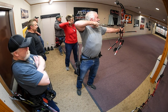 Hill Archery Club members take turns shooting their compound bows during a club league night Dec. 13, 2018, at Hill Air Force Base, Utah. The 20-yard indoor range at Hill's archery clubhouse houses five lanes for shooting. There are also four different outdoor ranges. (U.S. Air Force photo by Cynthia Griggs)