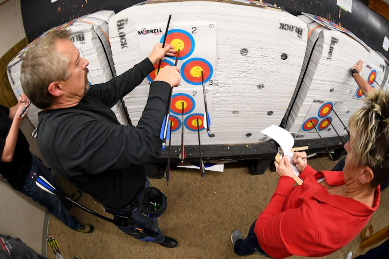 Hill Archery Club members Brian Wade and Shellay Williams tally up their points during a club league night Dec. 13, 2018, at Hill Air Force Base, Utah. The 20-yard indoor range at Hill's archery clubhouse houses five lanes for shooting. There are also four different outdoor ranges. (U.S. Air Force photo by Cynthia Griggs)