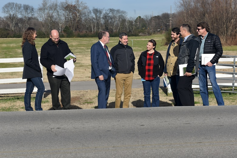 Stephen G. Durrett (wearing tie), programs director, professional engineer and member of Senior Executive Service with the U.S. Army Corps of Engineers Great Lakes and Ohio River Division, conducts a site visit Dec. 18, 2018 with Nashville District project managers, geologists and engineers near the footprint of the future Ellington Dry Dam to be constructed near Ellington Agricultural Center in Nashville, Tenn. The director provided the project delivery team with insight regarding the division's role in execution and related policy review and approvals for the detention basin project. (USACE photo by Lee Roberts)