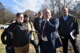 Craig Carrington (Left), U.S. Army Corps of Engineers Nashville District Planning Branch's chief of Plan Formulation, points out site specifics Dec. 18, 2018 of where Ellington Dry Dam will be located near Ellington Agricultural Center in Nashville, Tenn., while meeting with Stephen G. Durrett (wearing tie), programs director, professional engineer and member of Senior Executive Service with the U.S. Army Corps of Engineers Great Lakes and Ohio River Division. (USACE photo by Lee Roberts)