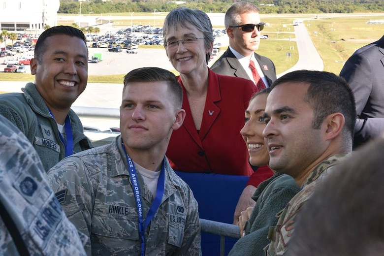 Secretary of the Air Force Heather Wilson takes a photo with 45th Space Wing Airmen at Cape Canaveral Air Force Station, Fla., Dec. 18, 2018. Wilson toured multiple facilities of Cape Canaveral and met with several 45th Space Wing Airmen. (U.S. Air Force photo by Airman 1st Class Dalton Williams)