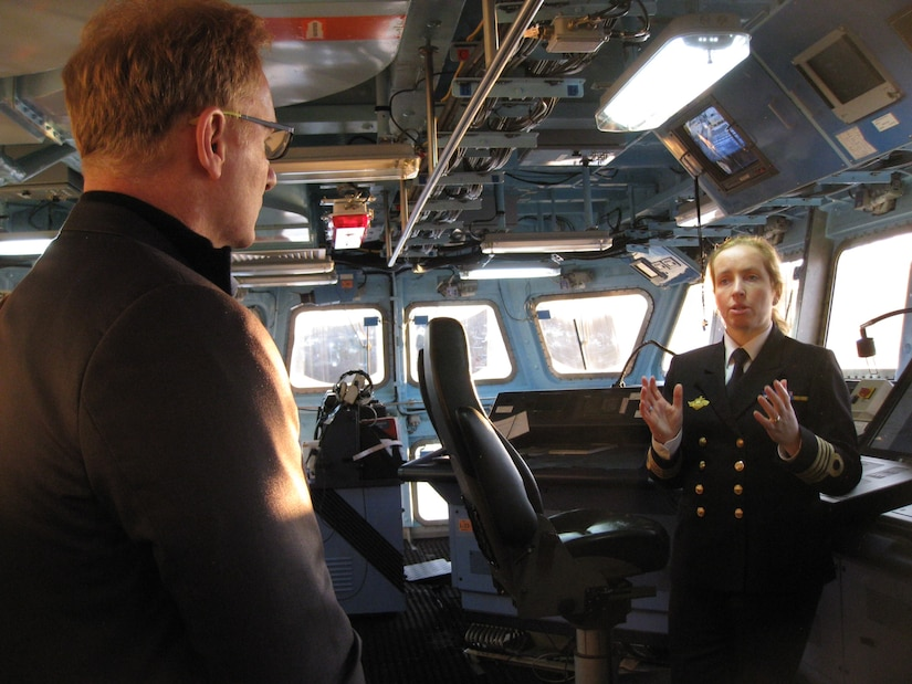 A Norwegian Navy officer speaks to U.S. Navy Undersecretary Thomas B. Modly.