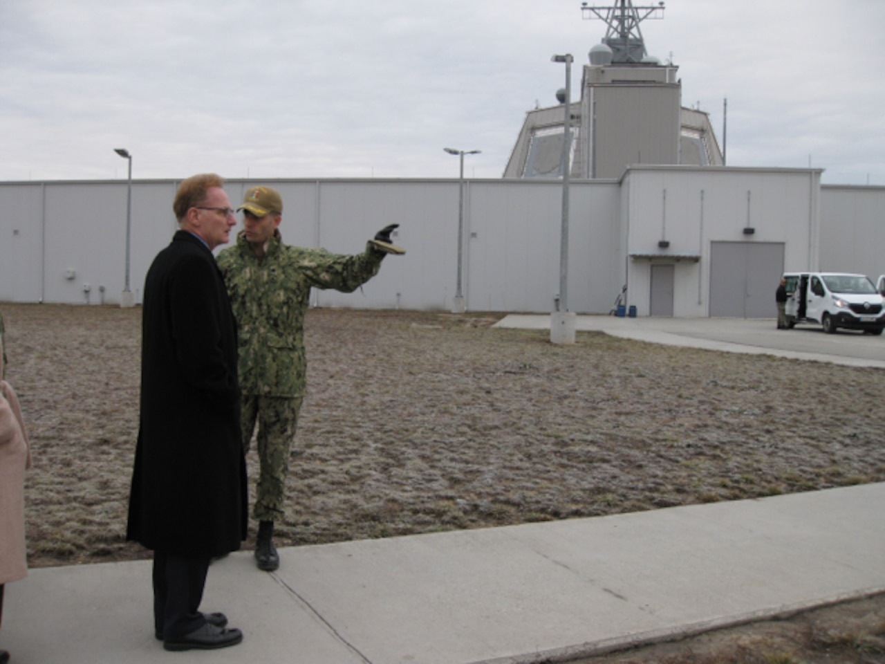 Navy Cmdr. Axel Steiner, right, commanding officer of U.S. Aegis Ashore Missile Defense System, gives Navy Undersecretary Thomas B. Modly a tour system at Naval Support Facility Deveselu, Romania.