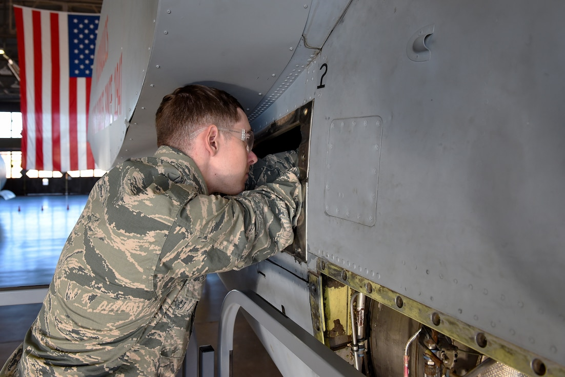 Airman Rendon McClain, 364th Training Squadron hydraulic systems apprentice course student, tightens the connection of two hydraulic hoses on a C-130 ground instruction training aircraft at Sheppard Air Force Base, Texas, Dec. 20, 2018. McClain, a native of Houston, made perfect scores on exams during the 49-day course to earn the distinction of being an ACE student. (U.S. Air Force photo by John Ingle)