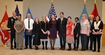 Army Brig. Gen. Mark Simerly, DLA Troop Support commander, poses with 11 employees during a retirement ceremony at DLA Troop Support Dec. 17, 2018 in Philadelphia. The retiring employees combined for 408 years of federal service.