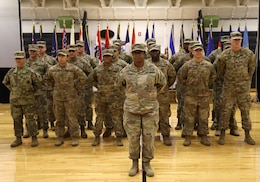 FORT KNOX, Ky. – Soldiers from the 1st Theater Sustainment Command stand at parade rest during the Blue Team Redeployment Ceremony at the Sadowski Center, Dec. 12. The team deployed to Kuwait in December and spent six-months there, traveling to various countries in the Middle East, in support of their mission. (U.S. Army photo by Mr. Brent Thacker)