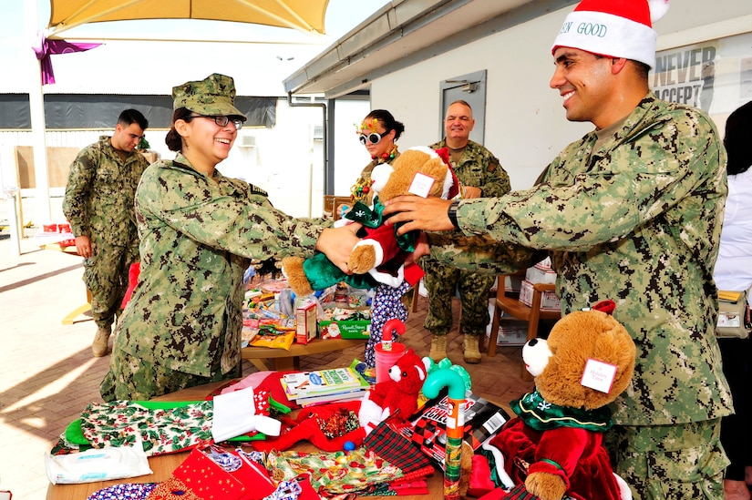 Sailors exchange gifts.